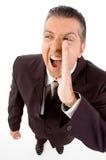 Shouting loud. An Aged businessman shouting loud Stock Photo