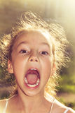 Shouting loud little girl at sunset Royalty Free Stock Photography