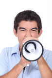 Shouting into loud speaker Stock Photos