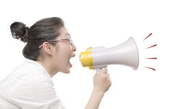 Shouting through loudspeaker. Woman shouting through loudspeaker on the white background Stock Photo