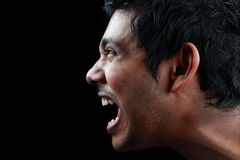 Shouting man. Side profile of a shouting face Stock Photography