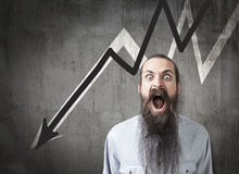 Shouting man and two declining white and black graphs on chalkbo Stock Photos