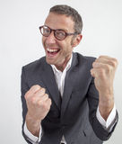 Shouting manager enjoying corporate success expressed with fun and humor Stock Photography
