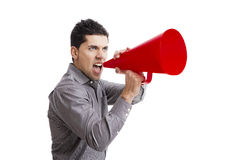 Shouting into a megaphone Royalty Free Stock Photo