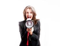 Shouting through megaphone. Business woman shouting through megaphone Stock Photos