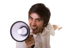 Shouting at the megaphone. Young men shouting at the megaphone (selective focus royalty free stock photos