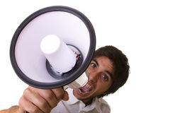 Shouting at the megaphone Royalty Free Stock Images