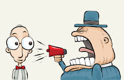 Shouting Megaphone Man. A loudmouthed man shouting at another man through a megaphone Stock Image