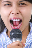 Shouting with microphone Royalty Free Stock Photos