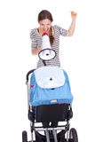 Shouting mother with megaphone and baby buggy Royalty Free Stock Image