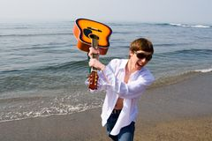Shouting musician. The musician shouts and swings a guitar royalty free stock photo