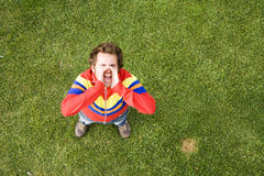 Shouting out loud. A high view perspective of a young man screaming ans shouting out loud Royalty Free Stock Images
