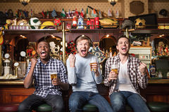 Shouting people. Expression fans with beer in pub Stock Photography