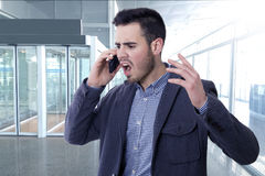 Shouting by the phone mobile. Man shouting by the phone mobile Royalty Free Stock Image