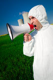 Shouting Protester. An environment protester shouting slogans through a loud-speaker against the pollution of nuclear power plants Stock Photography