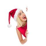 Shouting santa girl behind a placard Royalty Free Stock Images