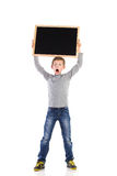 Shouting schoolboy with balckboard Royalty Free Stock Photos