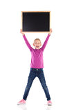 Shouting schoolgirl with blackboard. Stock Image