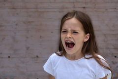 Shouting teenager girl. With dental braces Royalty Free Stock Photo