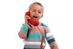 Shouting into a telephone. Complaining and screaming into a red telephone Royalty Free Stock Photo