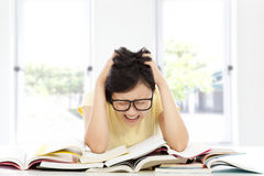 Shouting and tired  asian student girl at home Royalty Free Stock Images