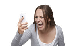 Shouting to mobile phone Stock Images