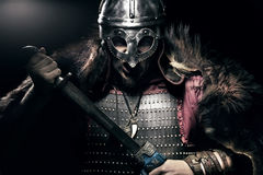 Shouting viking with sword and helmet over black background Royalty Free Stock Photography