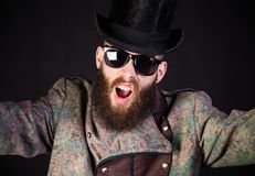Shouting weirdo. Strangely elegant hipster man in an unusual outfit staring Royalty Free Stock Photos