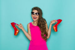 Shouting Woman Holding High Heels Stock Image