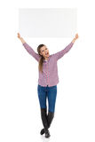 Shouting Woman Holding Placard Over Her Head Royalty Free Stock Image