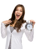 Shouting woman keeping alarm clock Royalty Free Stock Image