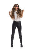 Shouting Woman In Leather Trousers Royalty Free Stock Photography
