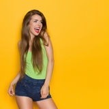 Shouting Woman In Lime Green Shirt Royalty Free Stock Image