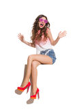 Shouting Woman In Pink Sunglasses Sitting On A Top Royalty Free Stock Photography