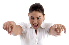 Shouting woman pointing with both hands Stock Photos