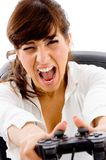 Shouting Woman Pressing Remote Button Royalty Free Stock Images
