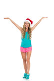 Shouting Woman In Sport Clothes And Santa Hat Royalty Free Stock Photos