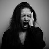 Shouting woman with unhappy, depressed crying face in big drief Stock Photography