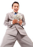 Shouting young businessman holding money Royalty Free Stock Photography