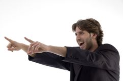 Shouting Young Man Pointing Sideways Stock Images