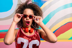 Shouting young woman with earphones Royalty Free Stock Image