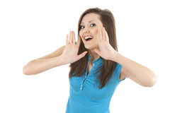 Shouting young woman with hands near face Stock Photos