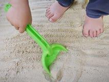 Shovel on the beach Stock Photo