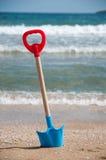 Shovel on beach Stock Photo