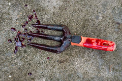 Shovel with blood Royalty Free Stock Images