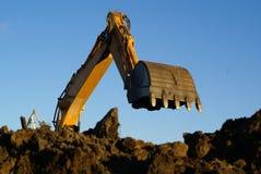 Shovel bucket against blue sky. Hydraulic excavator at work. Shovel bucket against blue sky Stock Image