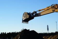 Shovel bucket against blue sky. Hydraulic excavator at work. Shovel bucket against blue sky Stock Photography