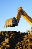 Shovel bucket against blue sky Royalty Free Stock Photo