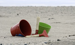 Shovel and bucket on the beach Stock Photos