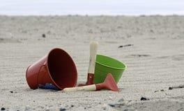 Shovel and bucket on the beach Stock Photos